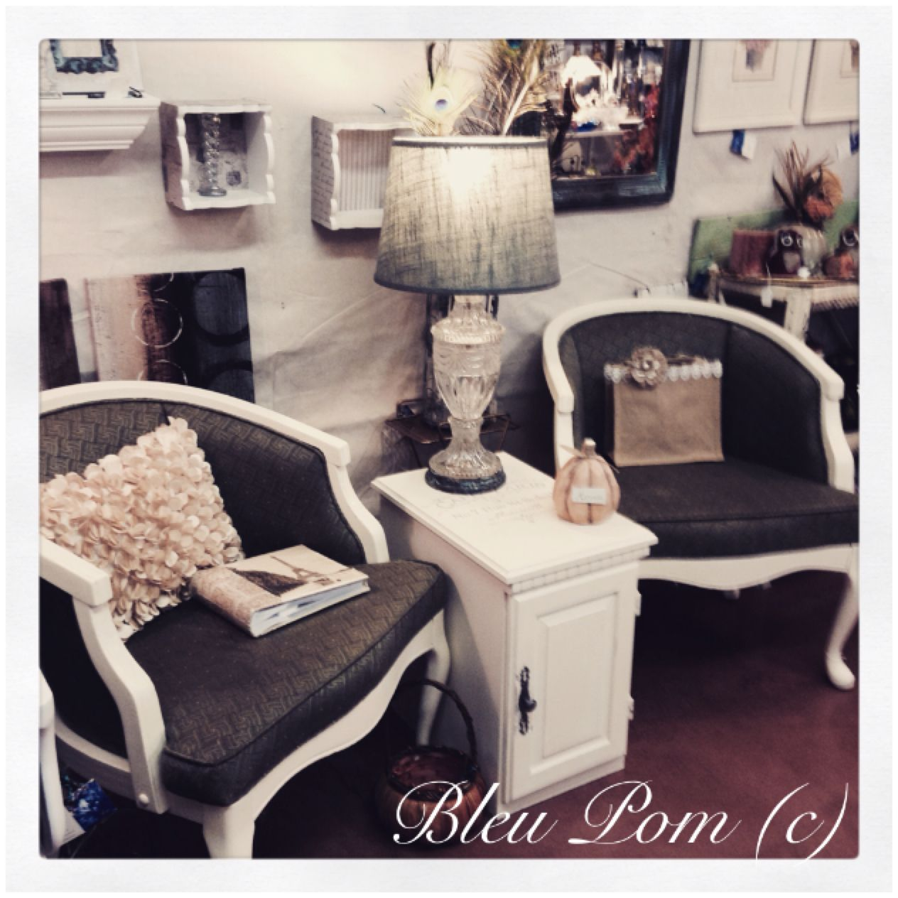 Sweet set, complimented by the patina crystal lamp. Located at Bleu Pom.