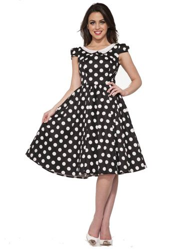 4e42d24ea4169 39.99 Hearts & Roses London Betty Black White Polka Dots Dress is made of a  black stretch cotton with large white polka dots.