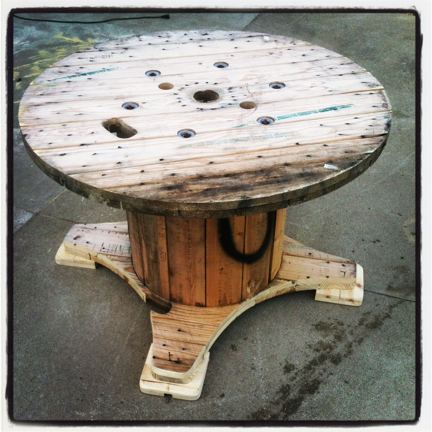 Table made out a discarded wire spool happiness bright and pallets table made out a discarded wire spool geotapseo Image collections
