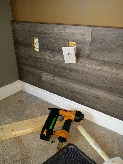 Wood laminate accent wall great room renovation - Laminate tiles for bathroom walls ...