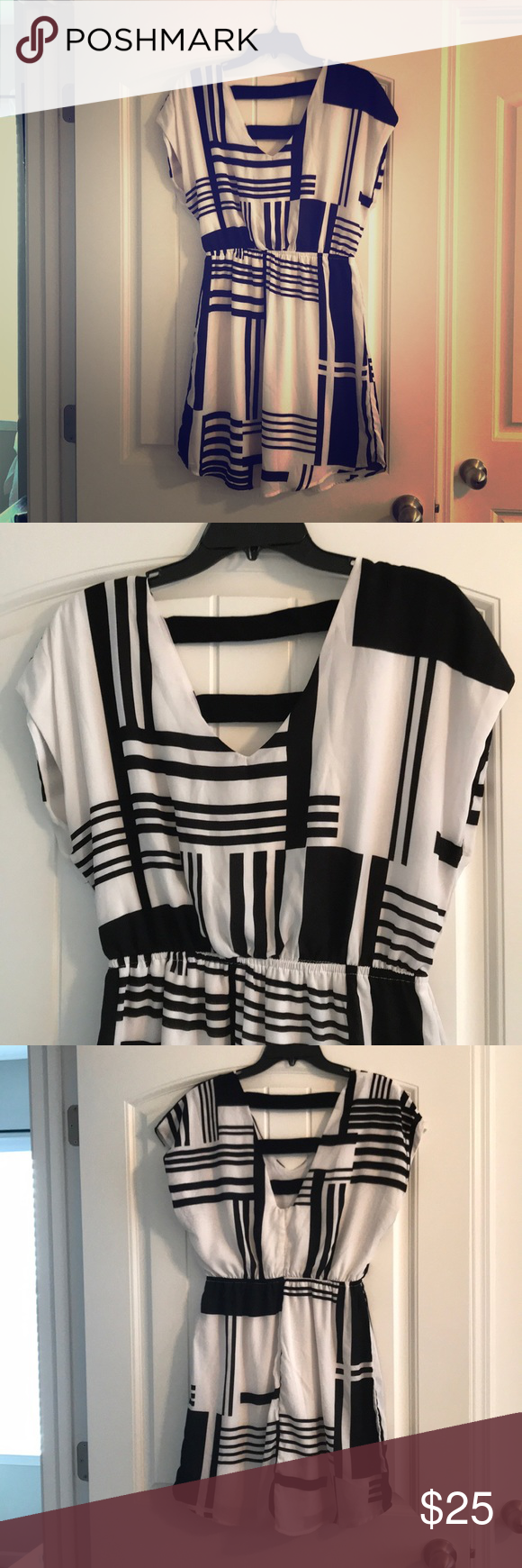 Black and white summer dress Very cute black and white summer dress, practically new, very soft, v-neck white a white slip attached underneath. Could be worn to a cocktail party or dress it down with a sun hat! Eyeshadow Dresses Mini