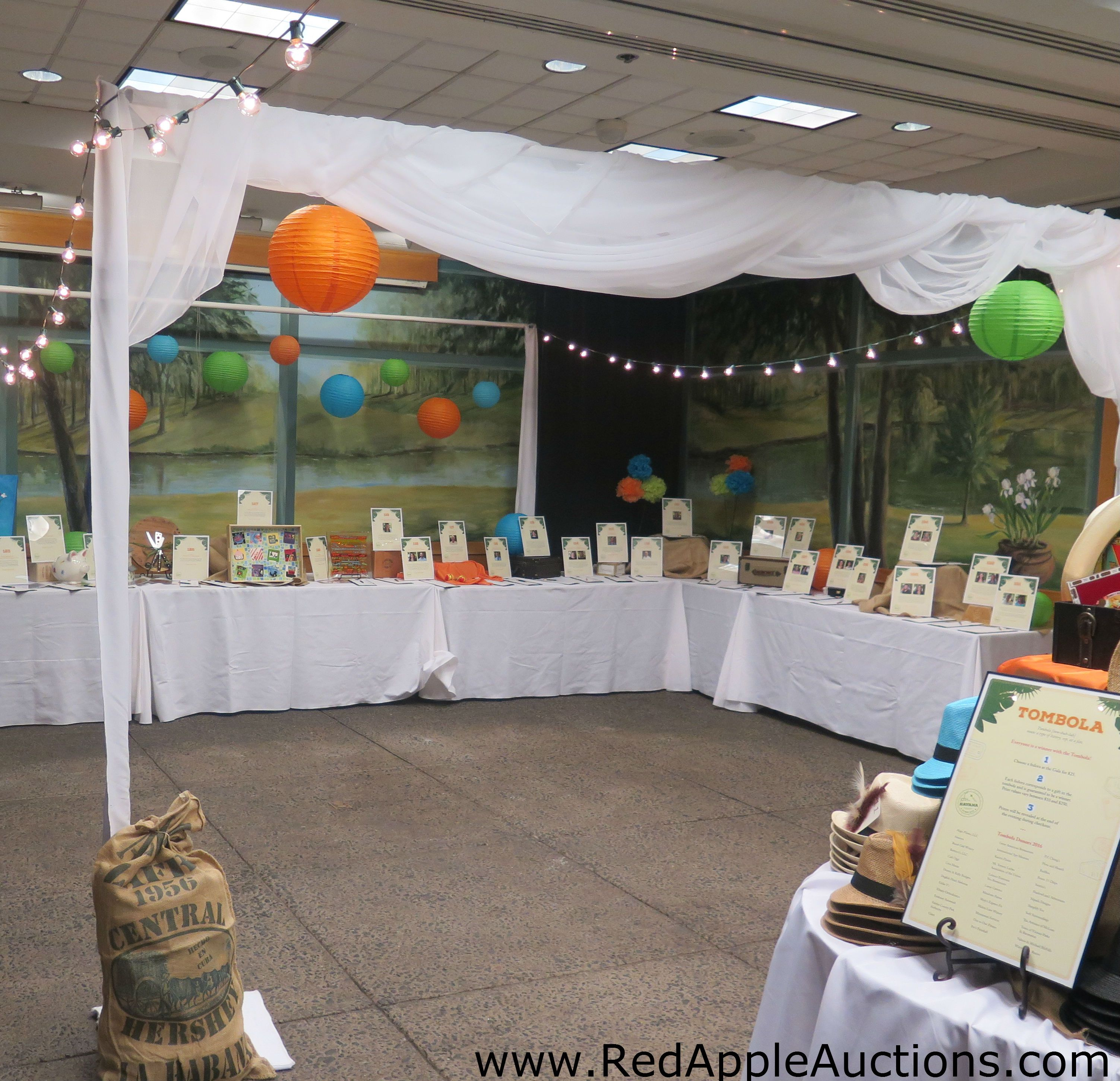 """At this Cuban-themed fundraising auction, the silent auction was """"tented"""" to add to ambiance.  #SilentAuctionDisplayIdeas"""