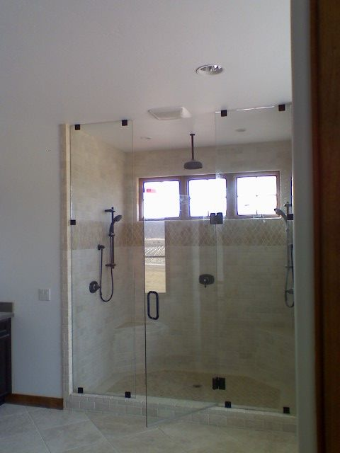 Custom Frameless Shower Door With Floor To Ceiling Fixed Panels And In The Middle