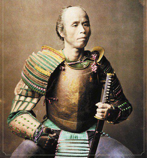 Portrait of a samurai in armour, photograph by Baron Raimund von Stillfried (attributed), handcolored, c. 1875.