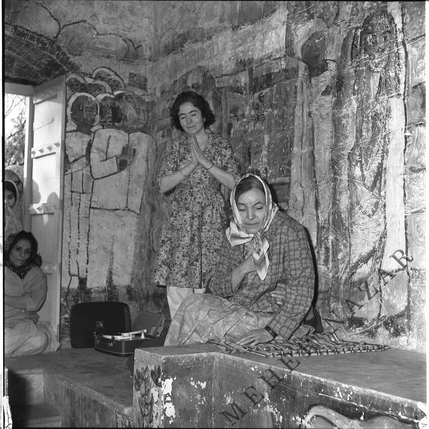 Mehera and Mani in Baba's tomb - shrine 1969