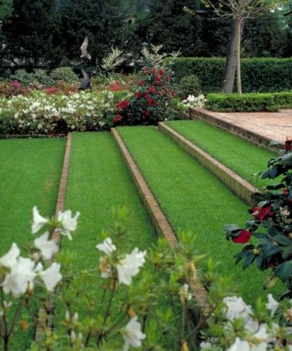 Large Terraces Creating A More Gentle Slope Sloped Garden