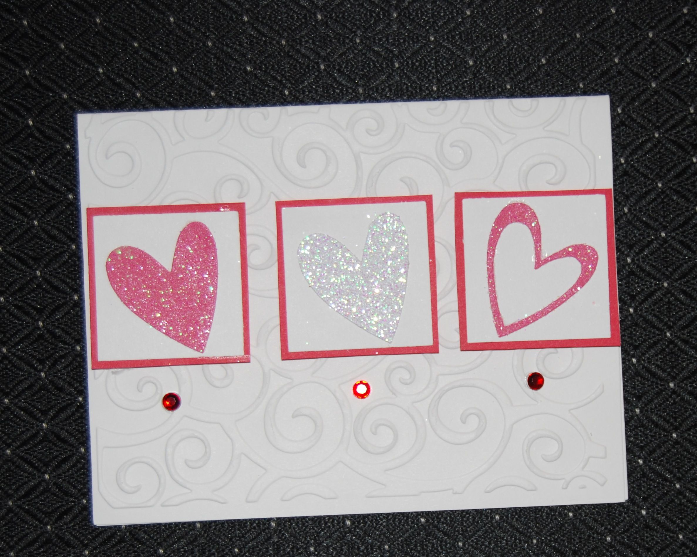 Valentine card 2012  Embossed background with glitter hearts