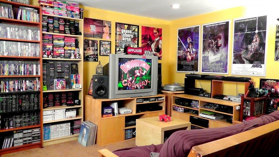 Admirable Video Game Room Interior Design Come With Yellow Walls And Maroon Cream Sofa And Brown Tv Cabinet Game Room Video Game Bedroom Video Game Room Decor