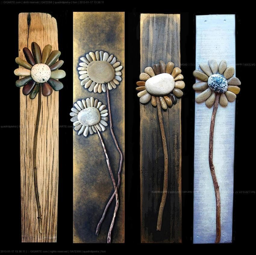 My Mom was forever scolding me as a child for all the rocks I'd always have in my pockets... Maybe this is something I could do with all the rocks I'm tempted to pick up, but don't anymore (mostly because I don't like holey pockets) flowers made of wood and rocks - garden craft