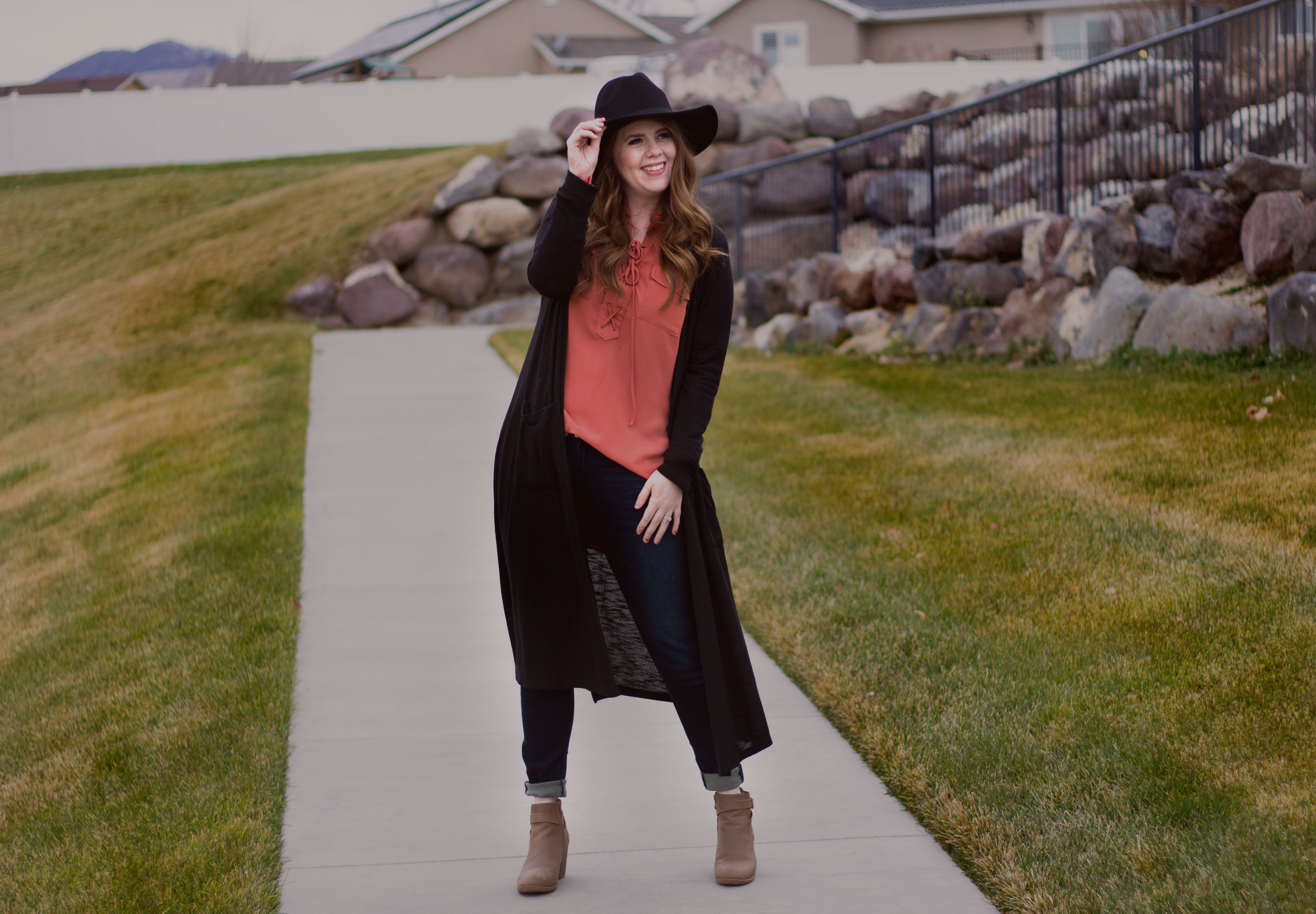 Styling a rust/burnt orange with black can be so chic with the right accessories. Add a neutral beige bootie with a black wide brimmed hat you have the perfect outfit.