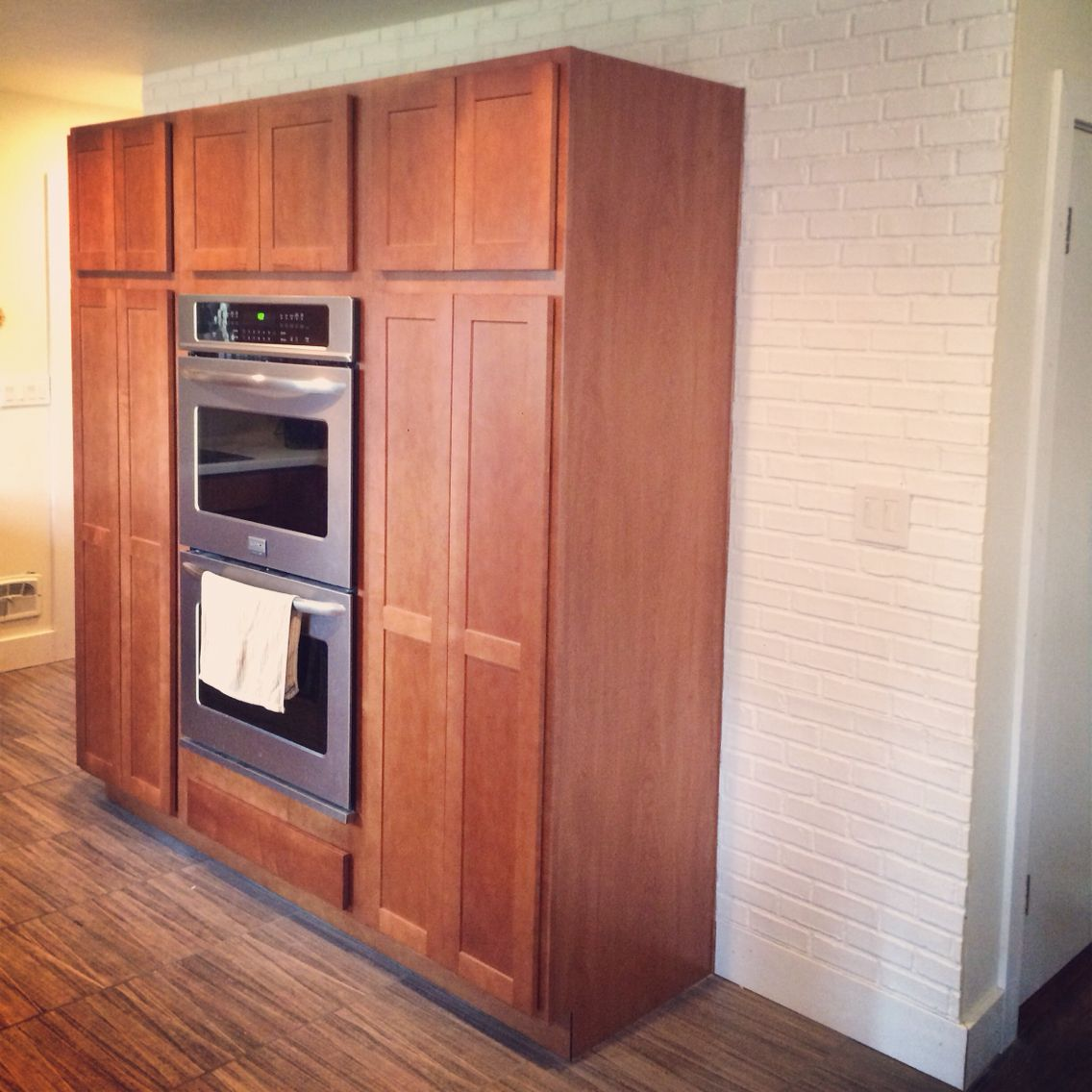 Kitchen remodel white faux brick. Diamond brand cabinets ...