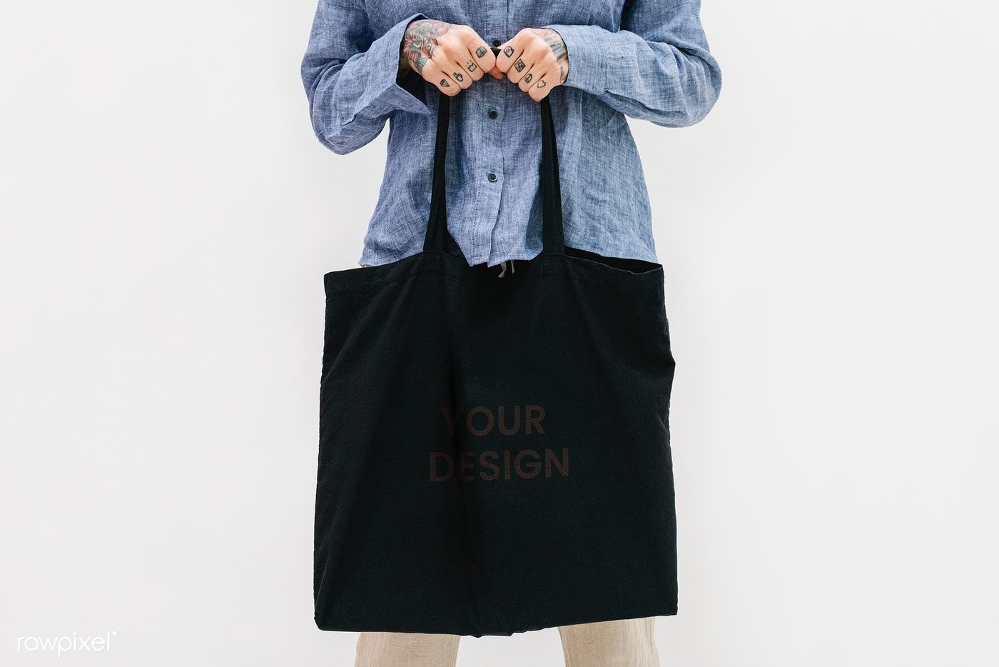 Download Download Premium Psd Of Tattooed Woman In A Blue Linen Shirt Holding A Linen Shirt Cotton Shopping Bags Black Tote Bag
