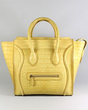 And someone...somewhere will be getting this $20,000K handbag off of Rue La La as a holiday gift. NOT ME!   Celine Yellow Crocodile Mini Luggage Tote