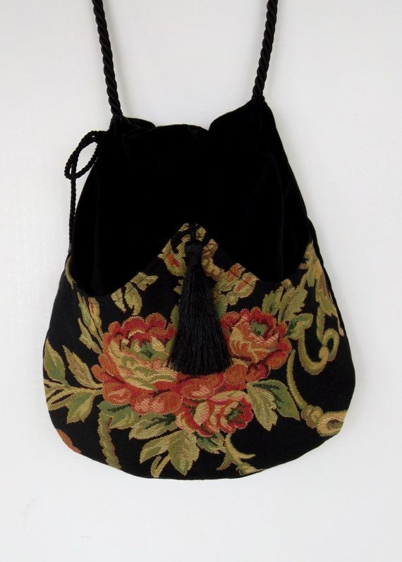 b442bdc19c09 Perfect bag for the free spirited lady. It has the richness of the red rose  tapestry pocket in front with a black tassel. The bag itself is black