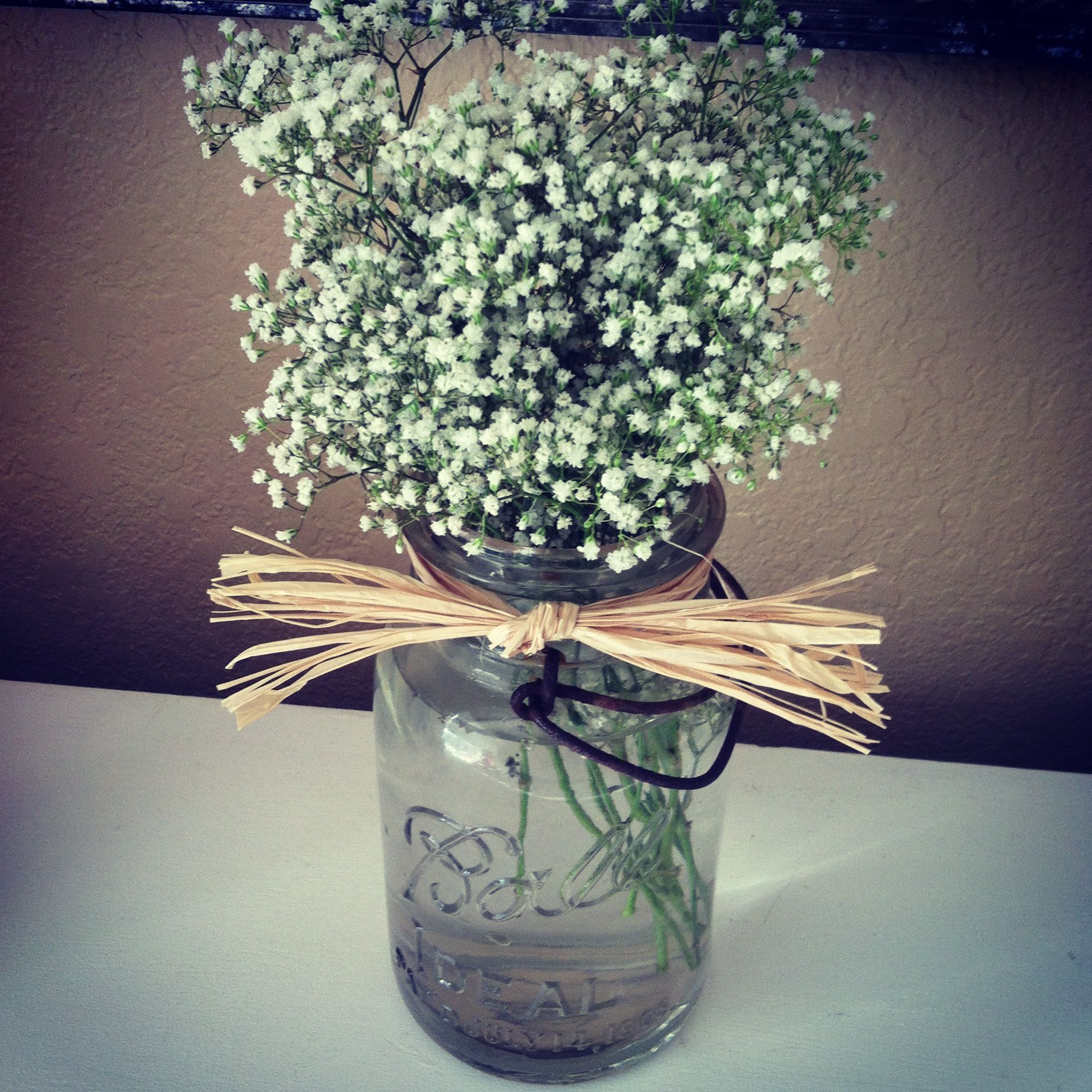 Baby S Breath Flowers In Mason Jars With Raffia Perfect For A Southern Wedding Babys Breath Babys Breath Flowers Rustic Party