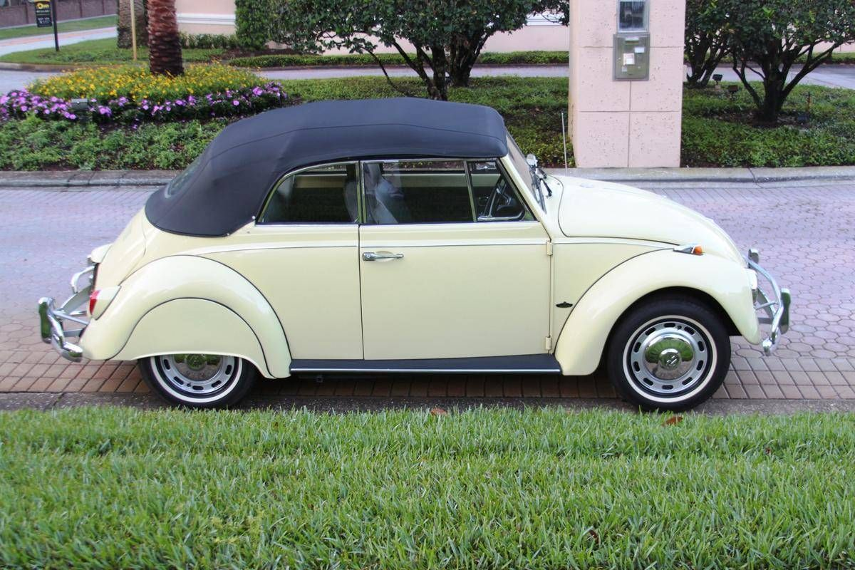 1967 VW Beetle 1500 Convertible. Total restoration including rebuilt motor, paint, chrome trim, top, working period AM/FM and add-on skirts.