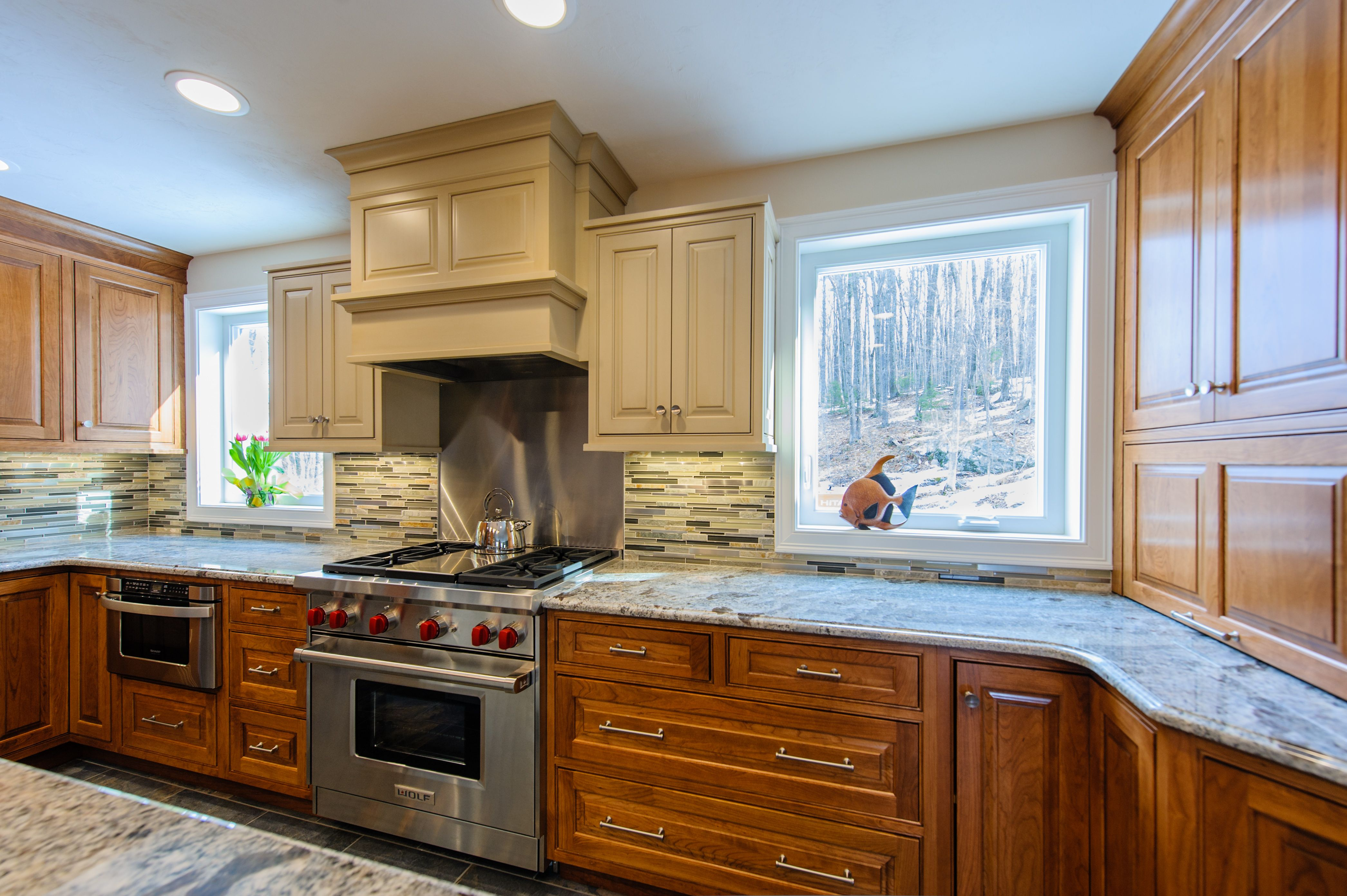 This Dura Supreme Kitchen Used Two Tone Cabinets To Draw Attention To The Decorative Wood Hood And Wolf R Kitchen Bathroom Remodel Kitchen Remodel Custom Homes