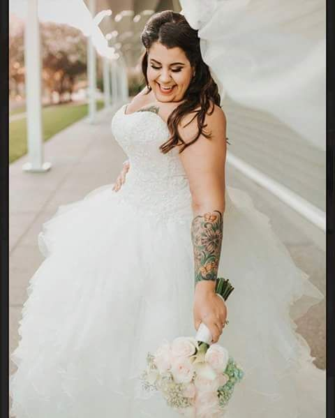Strapless plus size wedding gown with tulle ruffled skirt from Darius Bridal Plus size can get a totally from us that is made to measure and specific to their needs and w...