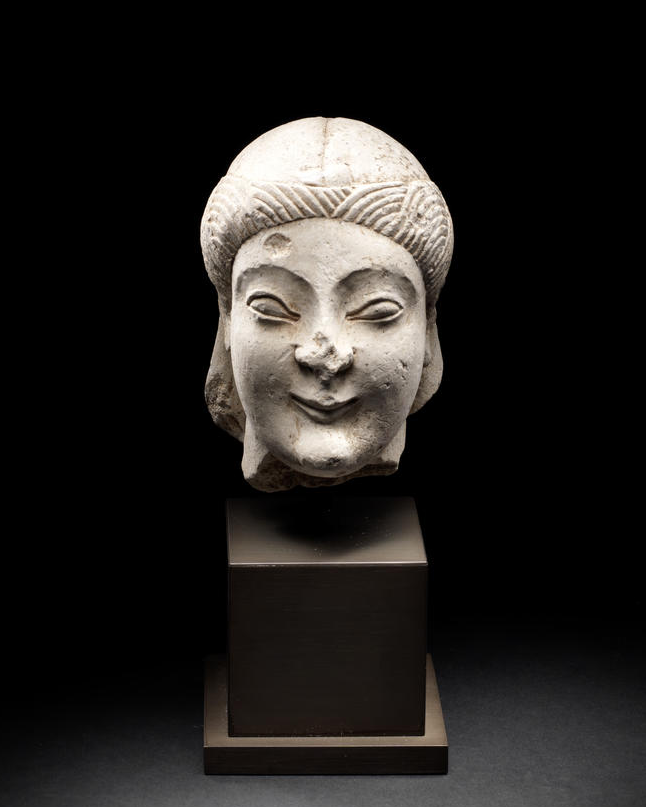 A Cypriot limestone head of a youth. Circa 5th Century B.C.