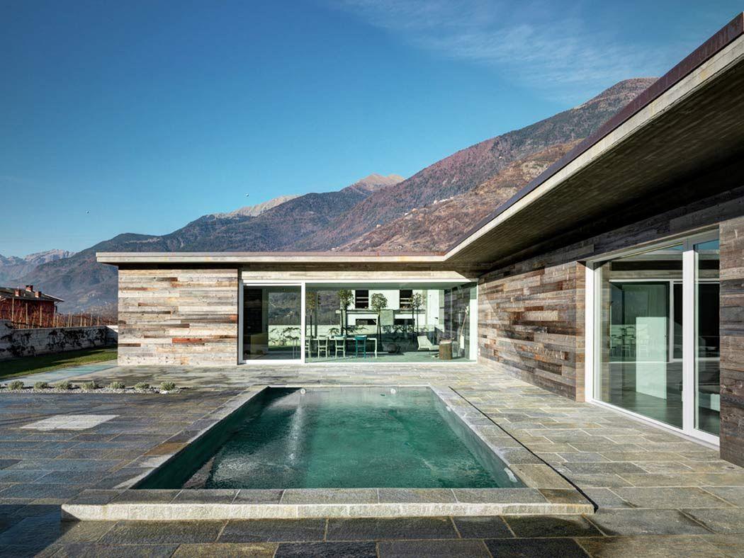 Stromlinienförmiges Haus in Italien Rocks Stone Oberflächen innen ...
