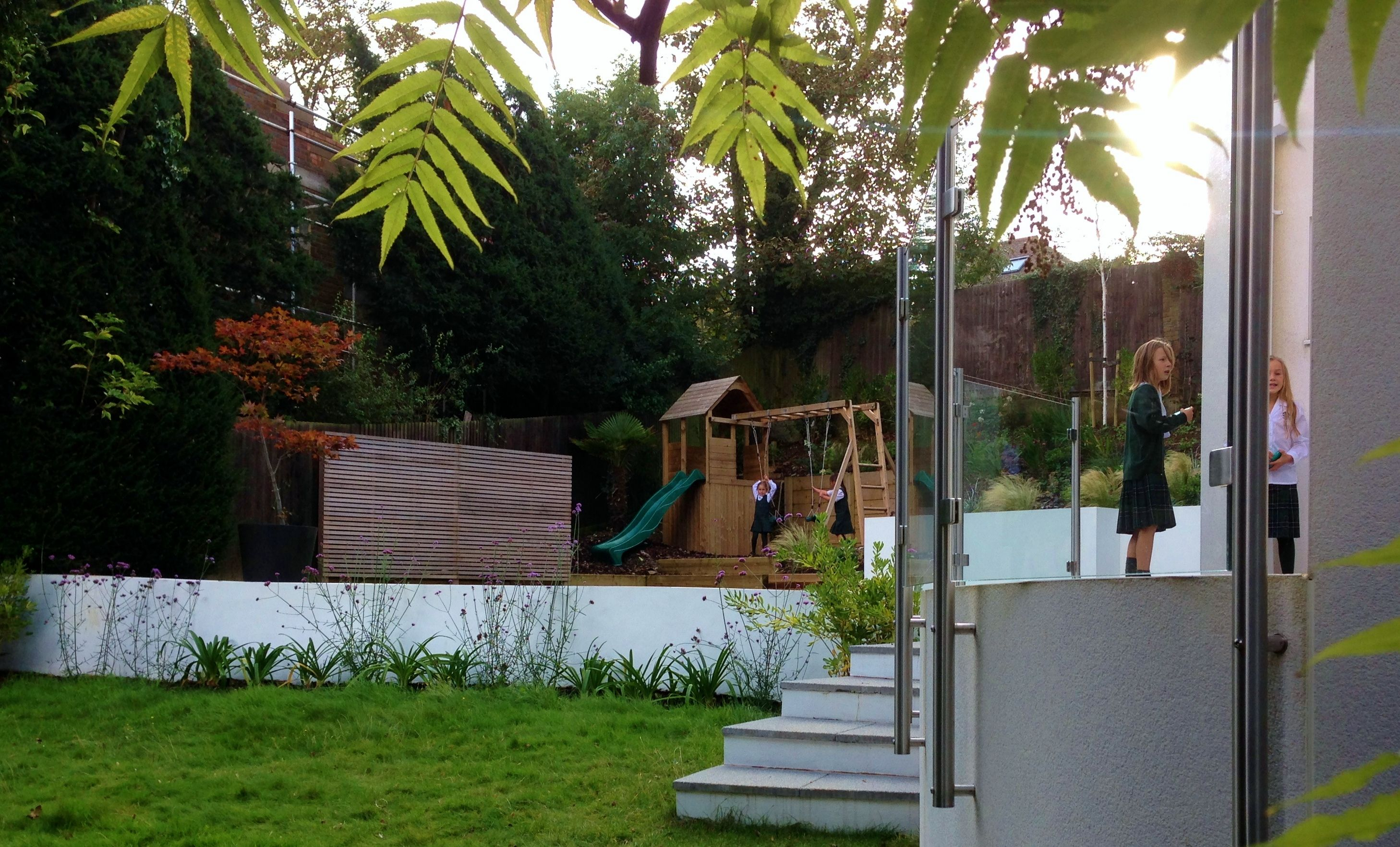 A combination of straight lines and naturalistic planting form the basis of this large garden in Brighton