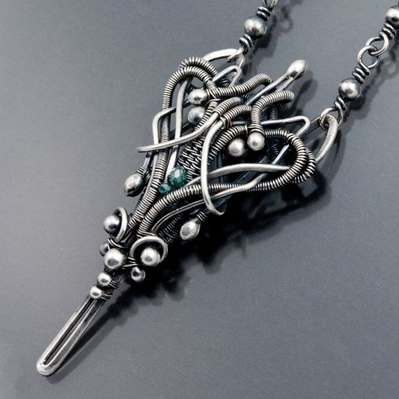 I really want this necklace. I love wire work.