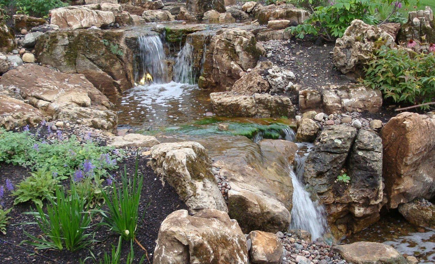 weathered limestone boulder water