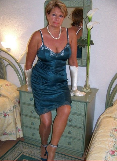 Mature woman in a satin slip