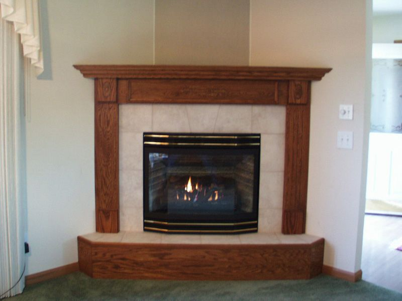wood fireplace surround with granite tiles hearth for the home rh pinterest com oak corner electric fireplace for sale oak corner fireplace tv stand