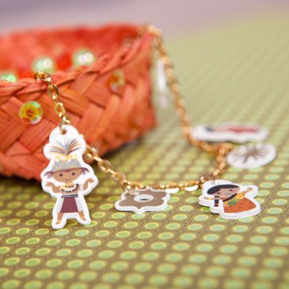 Add an adorable accent to any outfit with precious It's a Small World-themed shrink charms!