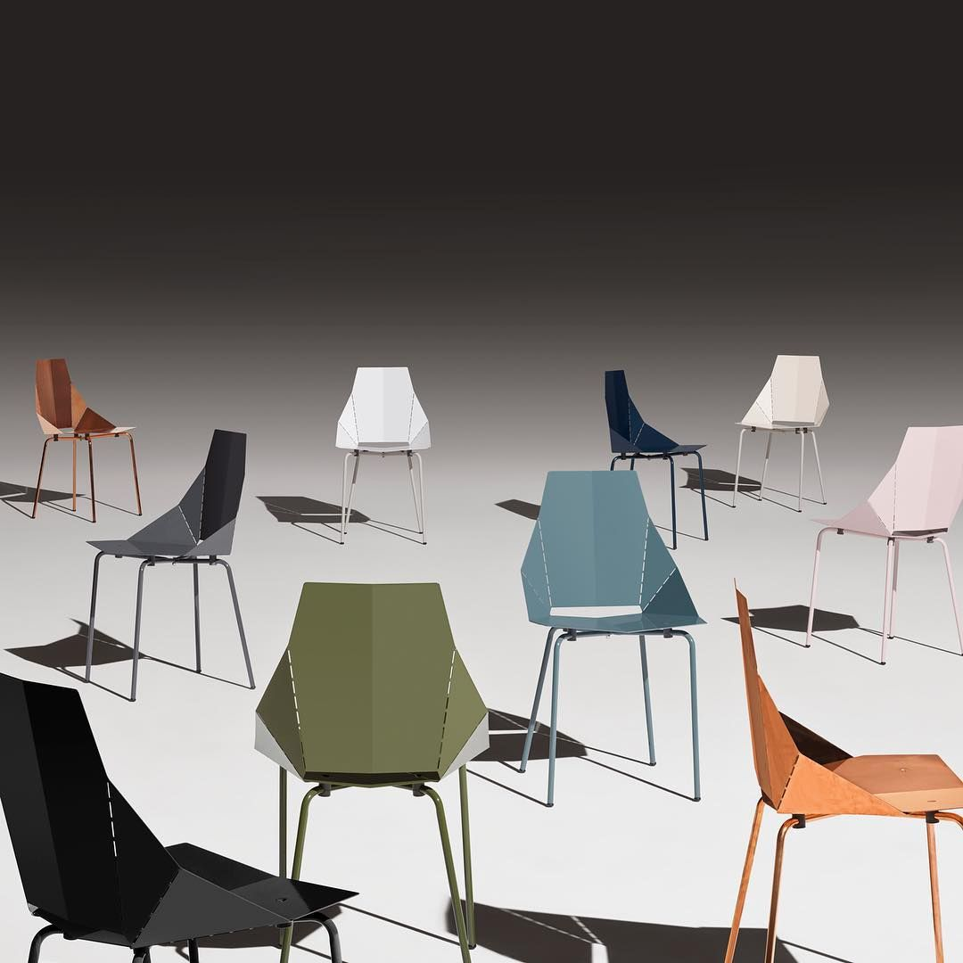 Set of armchairs and rocking chairs just out from beneath the shelter - Blu Dot Real Good Chair