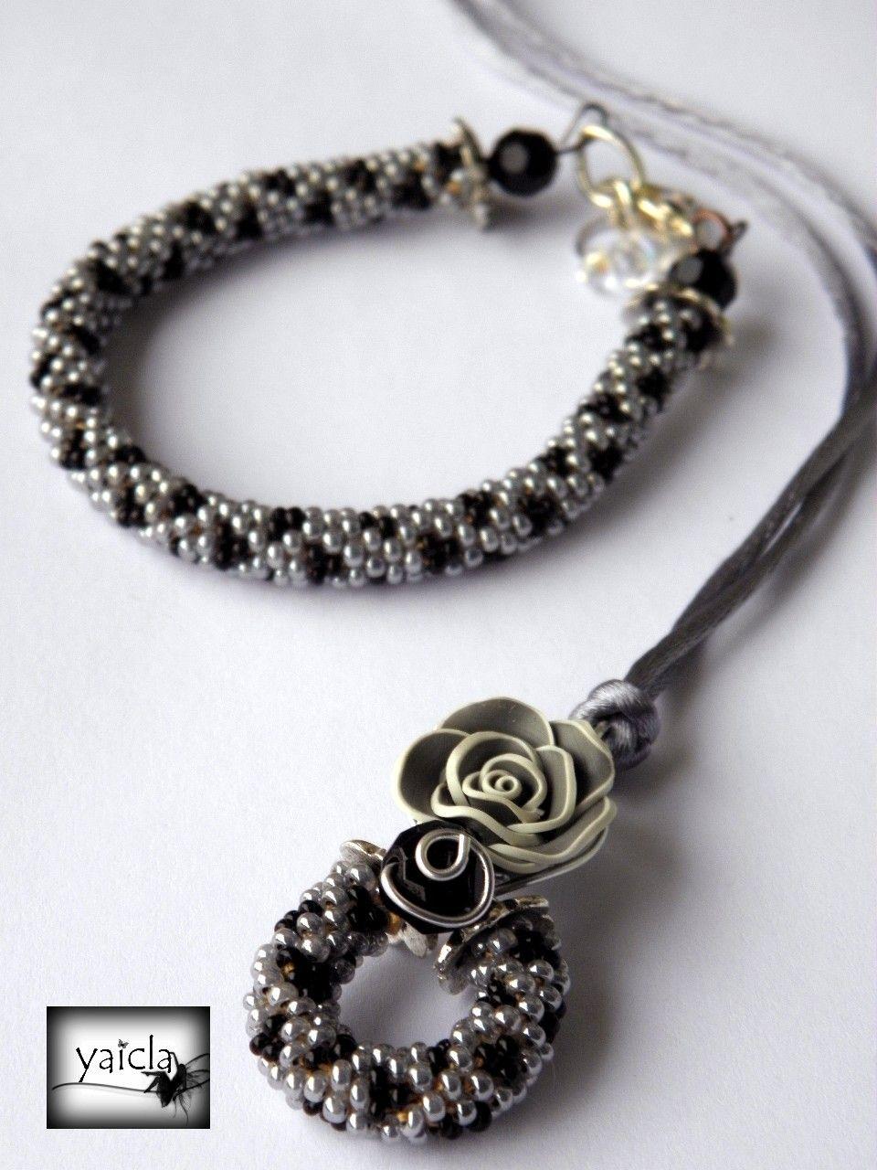 conjunto de colgante y pulsera en tonos negros y grises
