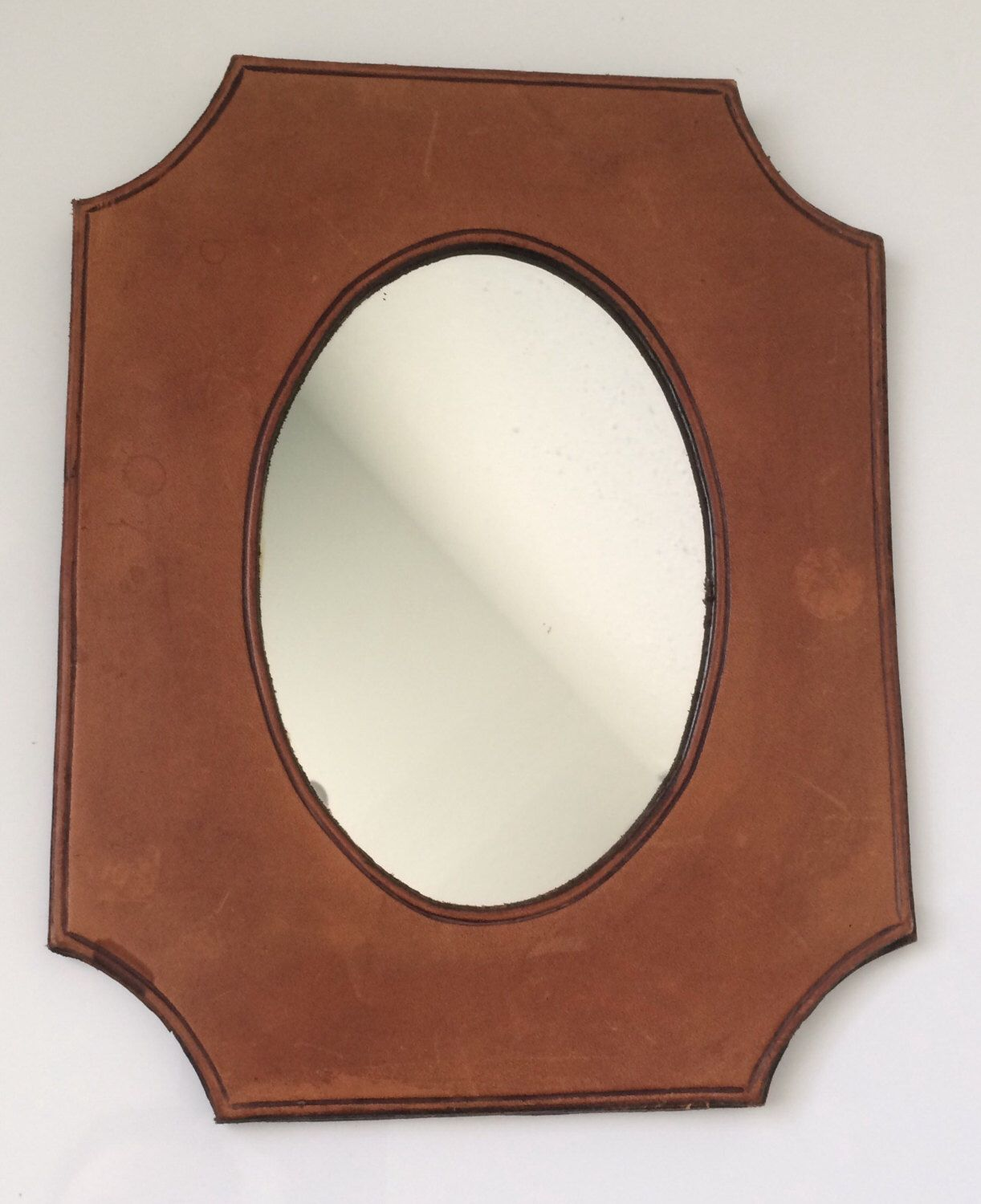 A personal favorite from my Etsy shop https://www.etsy.com/listing/493286955/vintage-brown-leather-framed-mirror