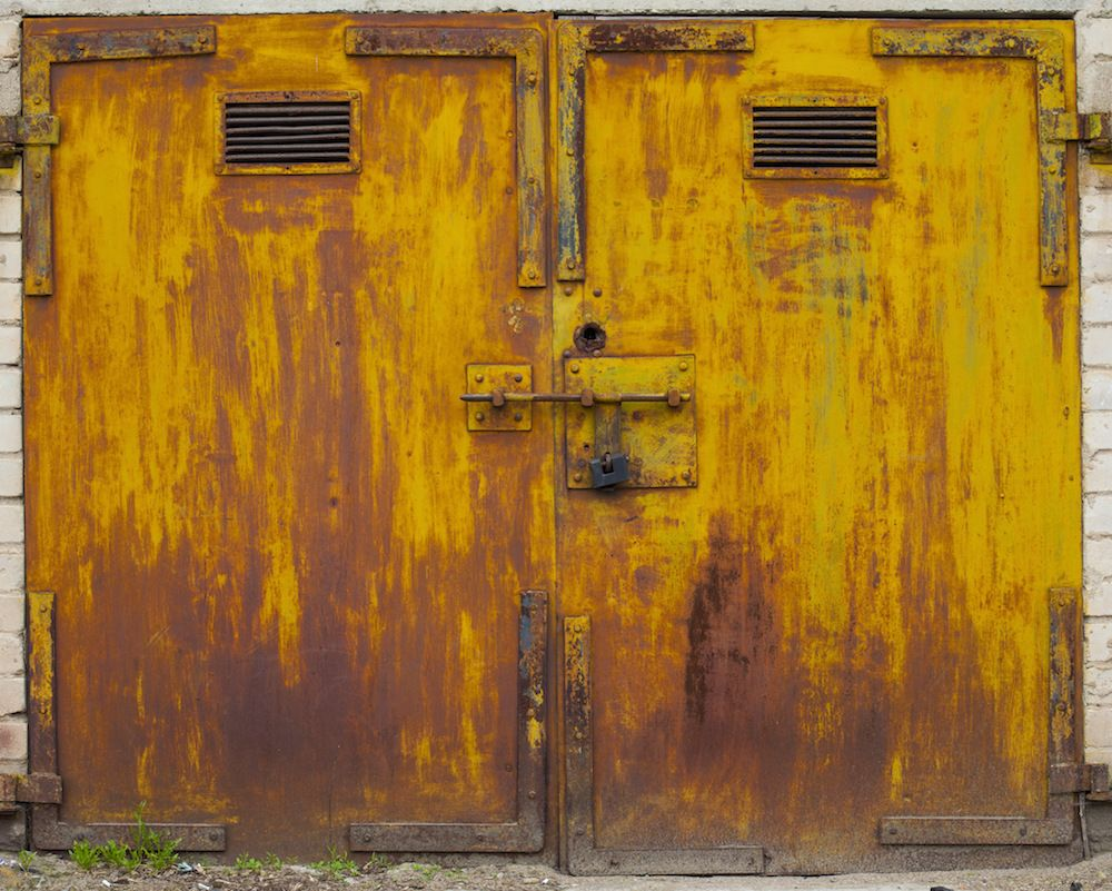 """Hundreds of Vibrant Doors Found Within Lithuania's """"Garage Towns"""" Photographed by Agne Gintalaite"""