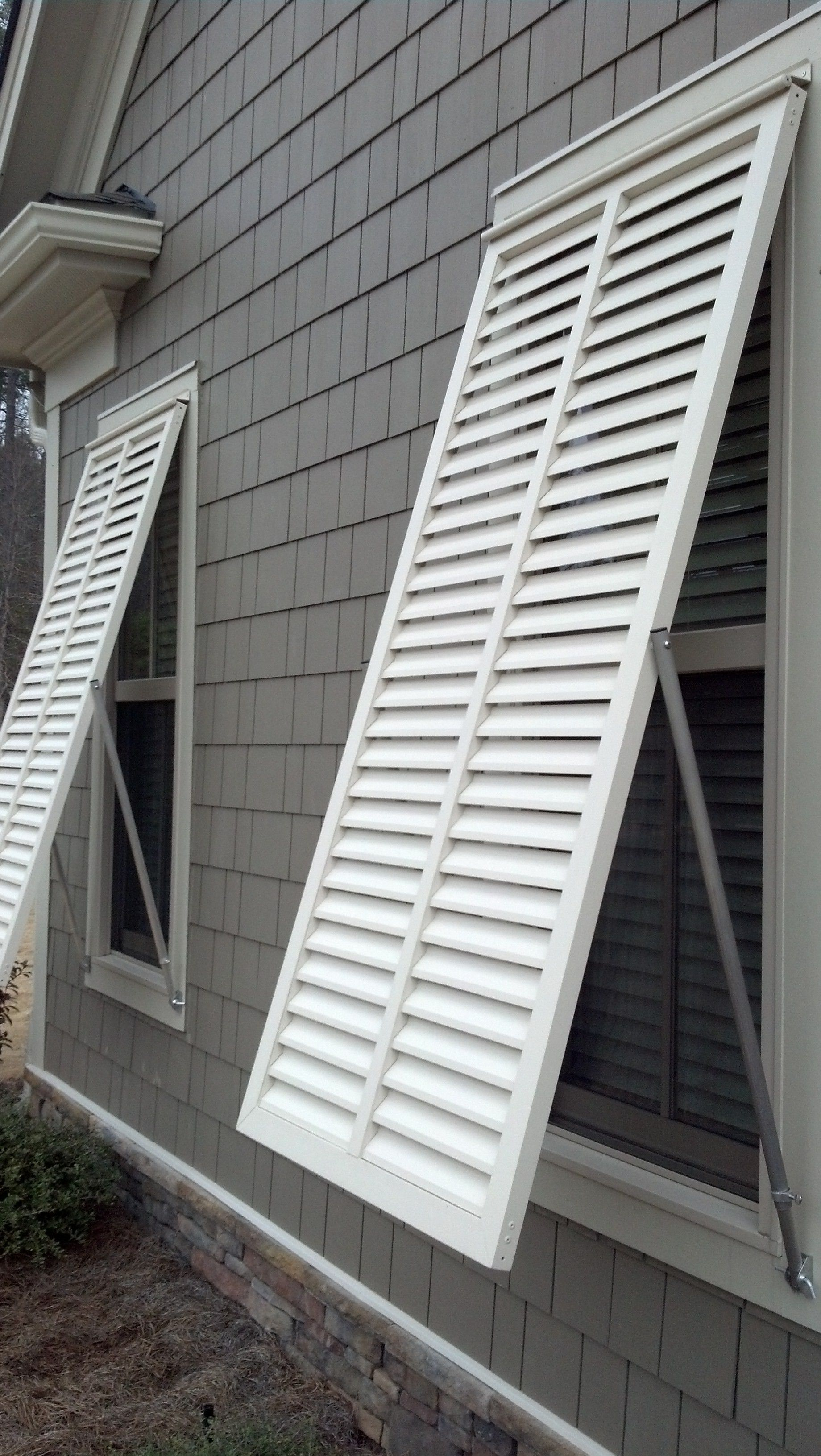 White bahama style exterior shutters by The Louver Shop | Beach ...