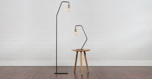 Starkey staande lamp zwart en messing designverlichting