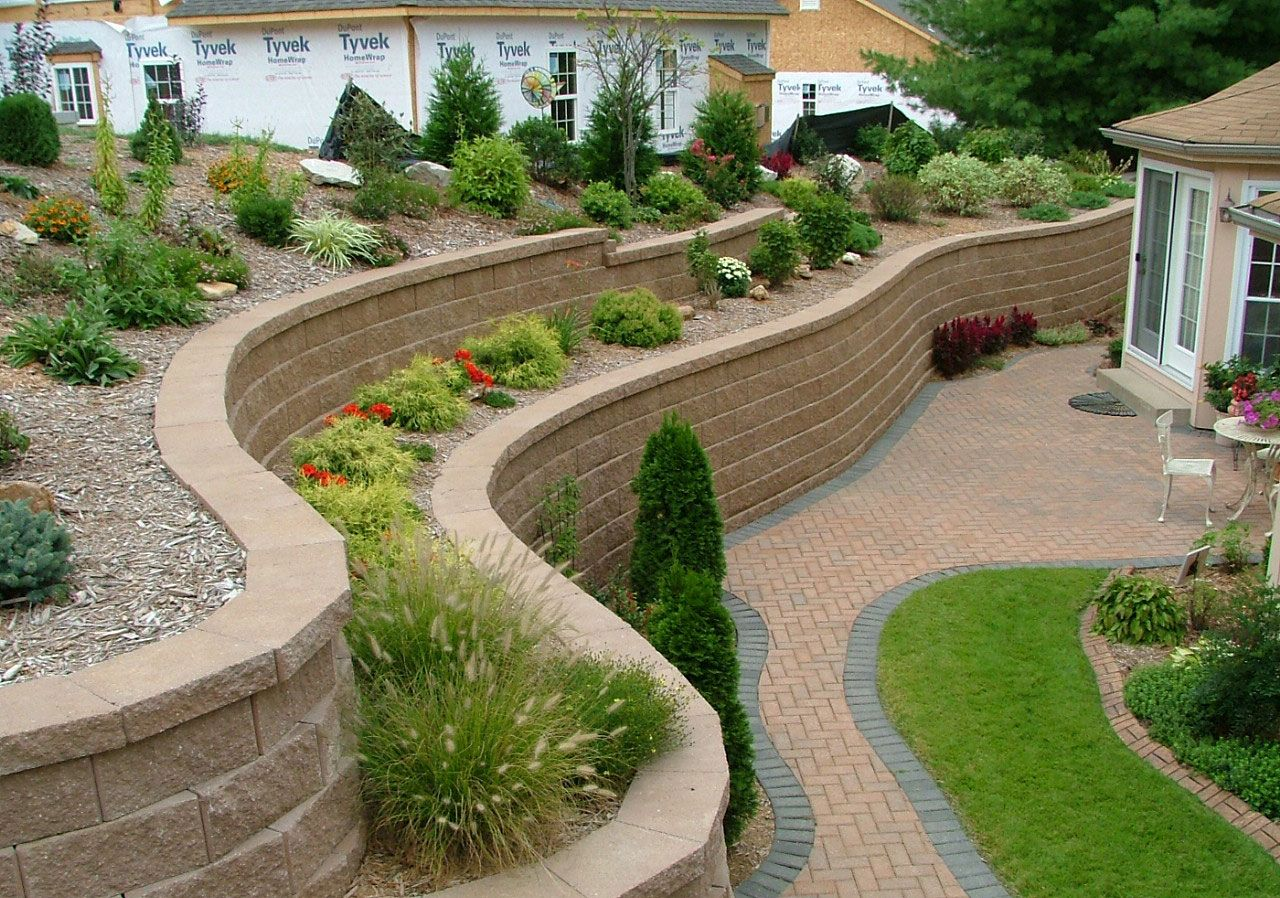Fantastic wavy retaining wall ideas from stone blocks for for Block wall landscape design