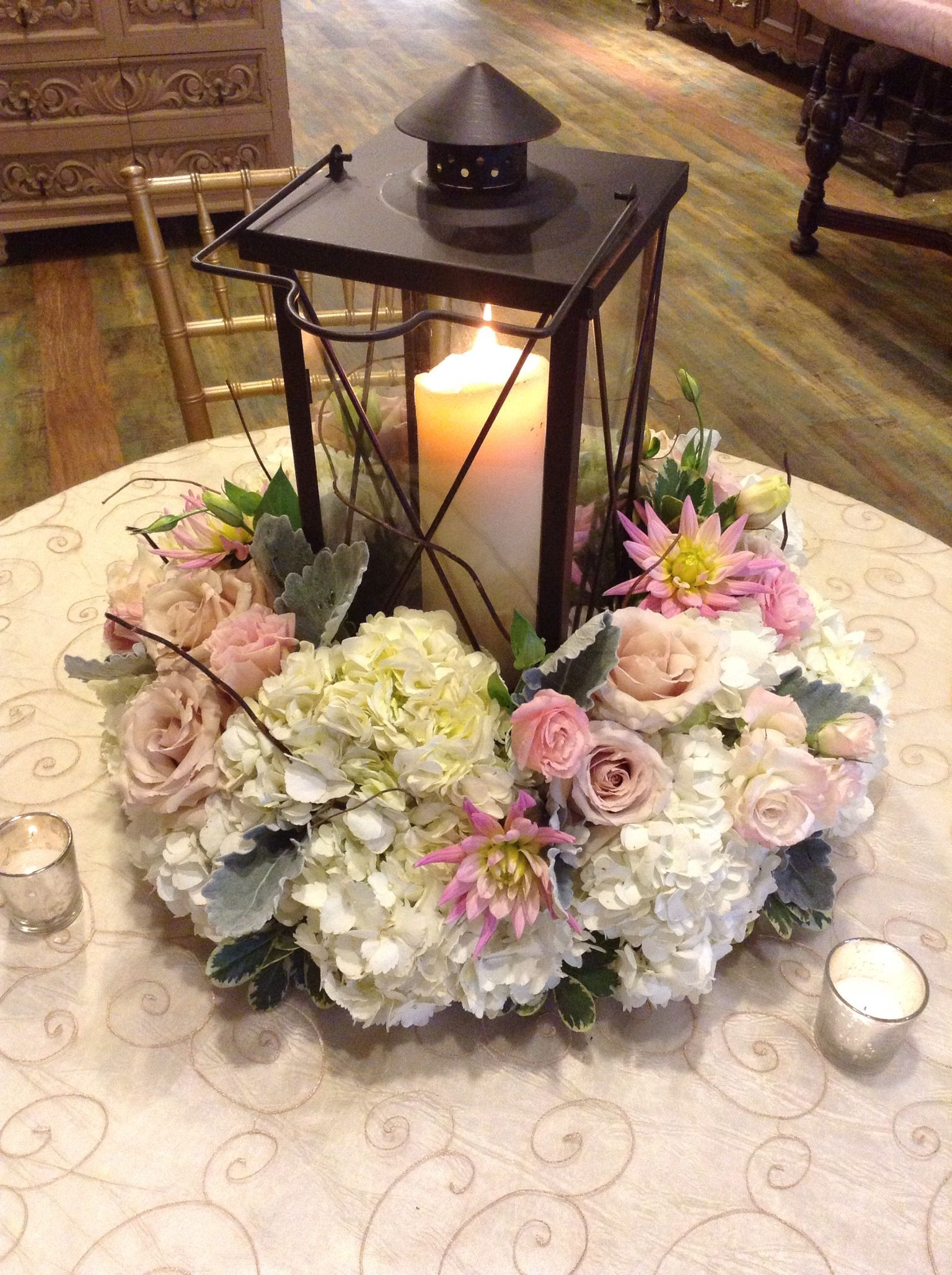 A beautiful lantern centerpiece surrounded by white