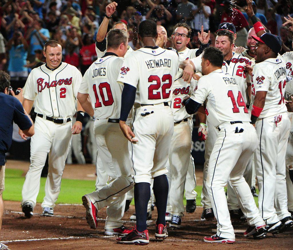 Chipper Jones 10 Of The Atlanta Braves Is Mobbed By Teammates After Hitting A Three Run Walk Off Home Run Agains With Images Atlanta Braves Braves Atlanta Braves Baseball