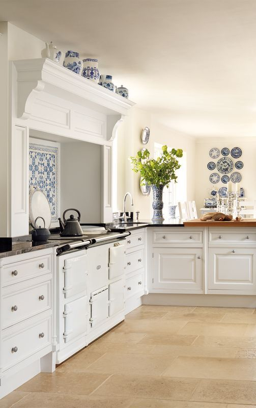 White Kitchen With Blue Plates Hung On Wall Bluekitchen Blue And White Kitchen Decor Insp Classic White Kitchen White Kitchen Decor Kitchen Decor Inspiration