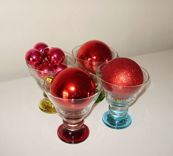 decorate with christmass balls. Red christmass ornaments in glasses