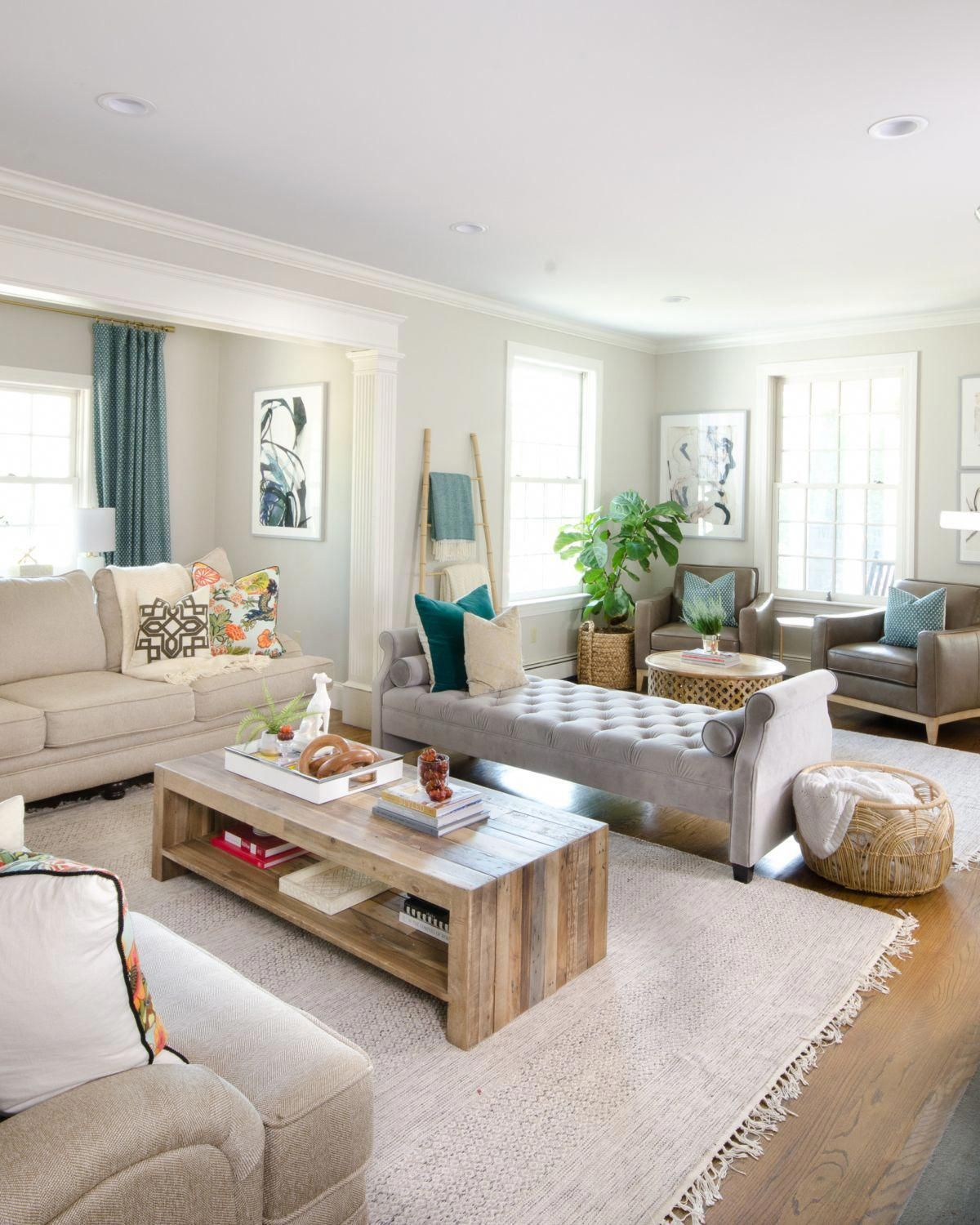 Beautiful Neutral Family Room With Pops Of Color And Wood Accents Backless Sofa Large Living Room Layout Long Living Room Layout Living Room Furniture Layout