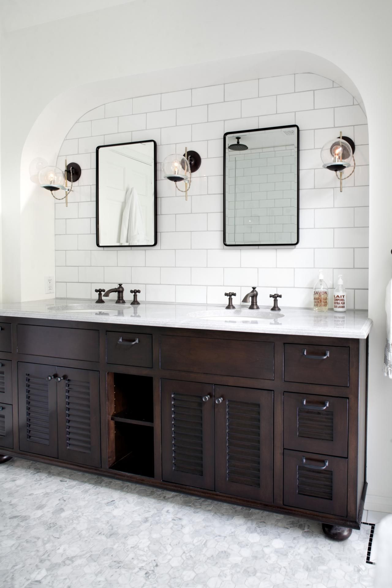 Attractive A Beautiful Arch Shape Frames The White Tile Wall Above This Double Vanity. Dark  Wooden