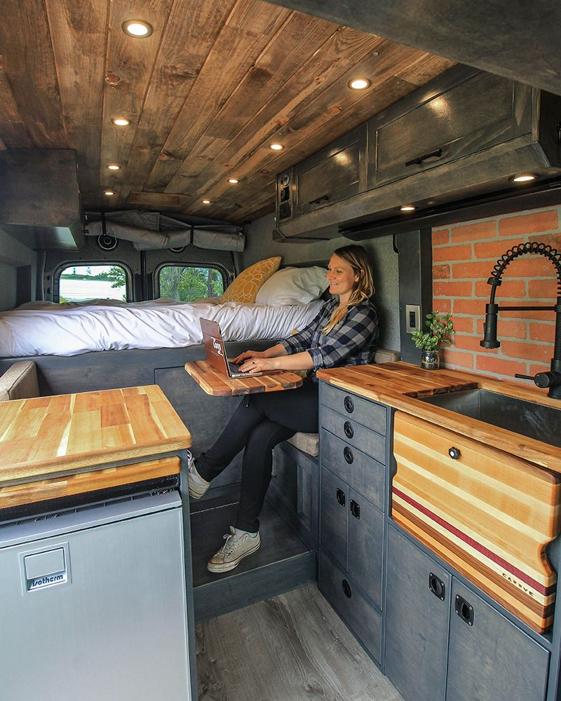 These mobile office solutions created by digital nomads will inspire you to hit the road. Photo from Freedom Vans #mobiledesk #digitalnomad #deskideas #mobileworkspace #digitalnomad #mobileworkspace #homeontheroad #rvdesk #tinyoffice #officeonwheels #vanlife #vanconversion #freedomvans