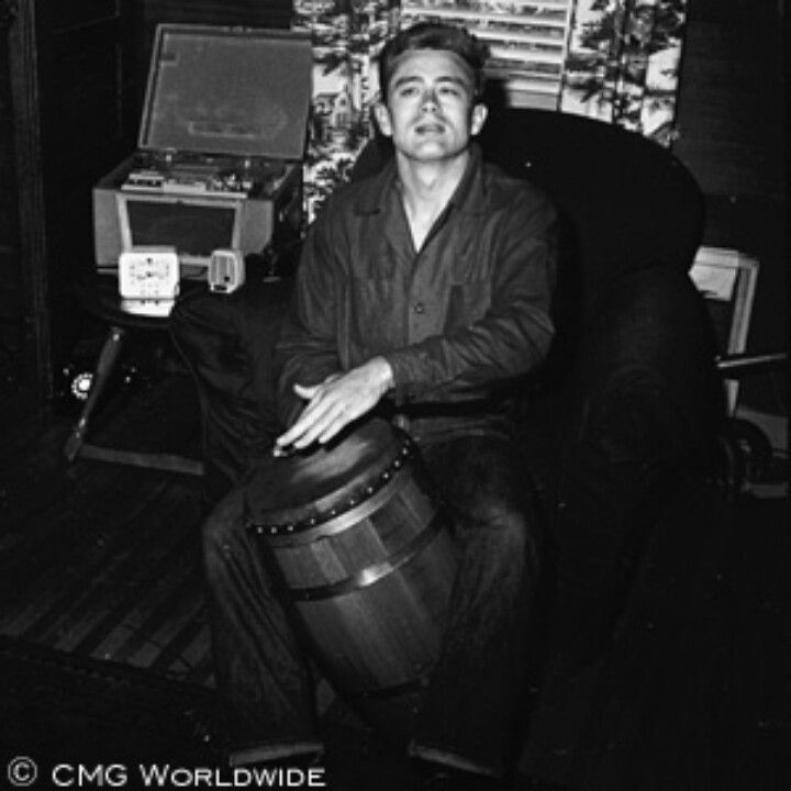 James Dean playing the bongo drums