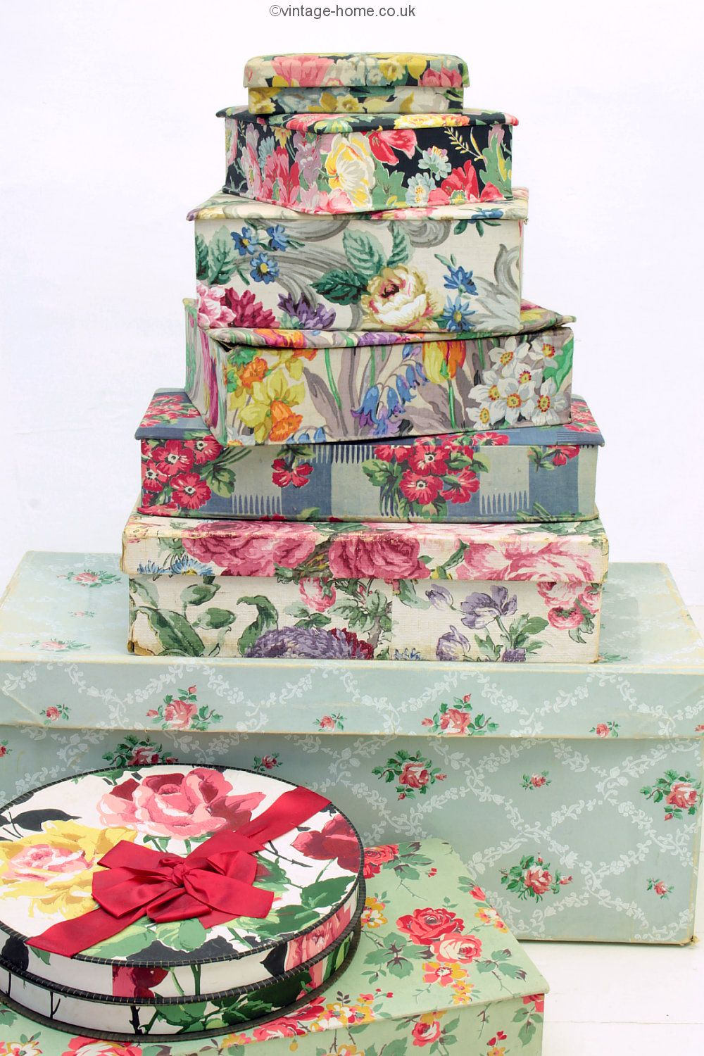 A few of my time-worn vintage fabric and wallpaper covered boxes ...
