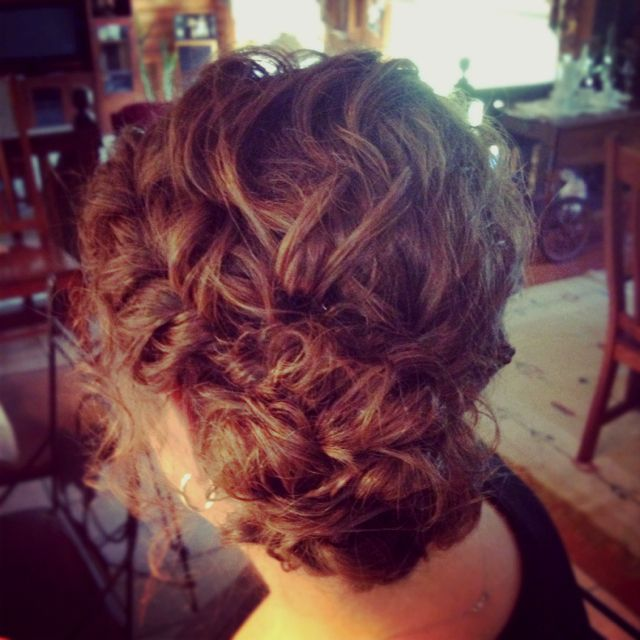 Messy bun with twists for curly hair!