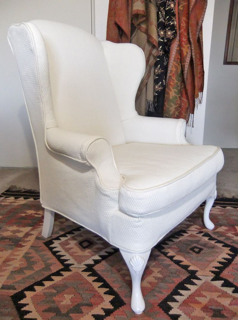 Wingback chair slipcover in natural diamond matelasse from