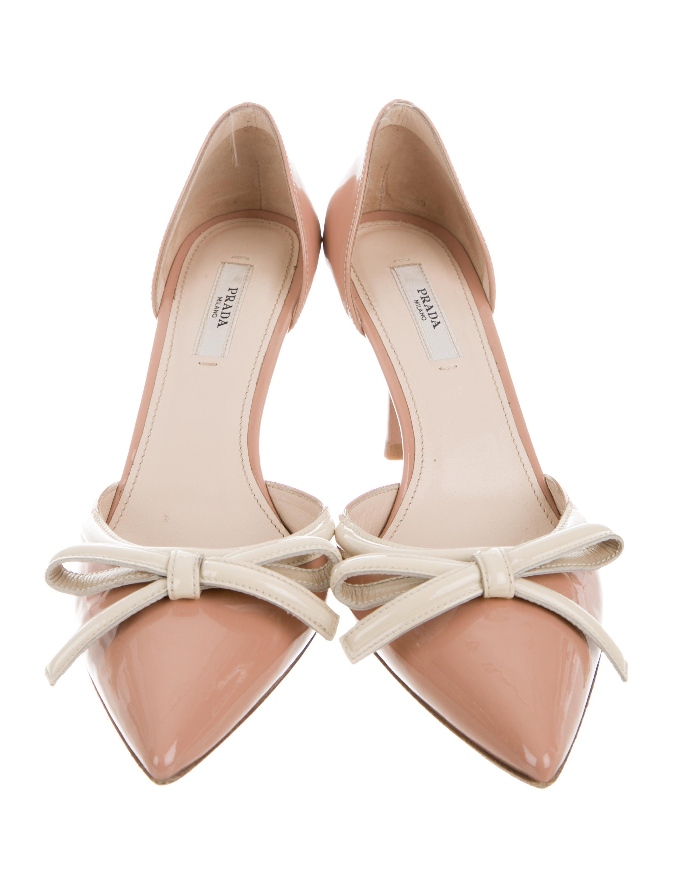 ee960a9ed623c Tan and beige patent leather Prada pointed-toe pumps with bow accents at  uppers and covered heels. Includes dust bag.
