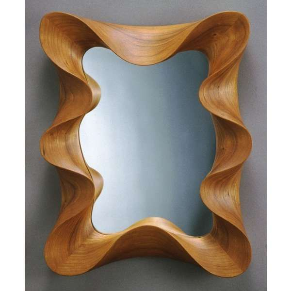 Uma Mirror with an undulating frame carved from a single piece of ...